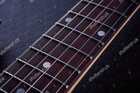Detail Of The Rosewood Fingerboard On A Vigier Excalibur Supraa Electric Guitar With A Clear Red Finish