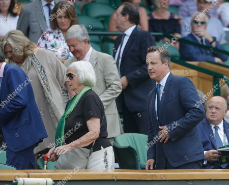 Former British Prime Minister David Cameron and his mother Mary Cameron arrive in the Royal Box on Centre Court on the fifth day of the Wimbledon Tennis Championships in London