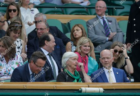 Former British Prime Minister David Cameron, his mother Mary Cameron and former British Foreign Secretary William Hague, right, sit in the Royal Box on Centre Court on the fifth day of the Wimbledon Tennis Championships in London