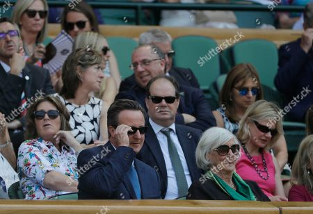 Former British Prime Minister David Cameron and his mother Mary Cameron sit in the Royal Box on Centre Court on the fifth day of the Wimbledon Tennis Championships in London