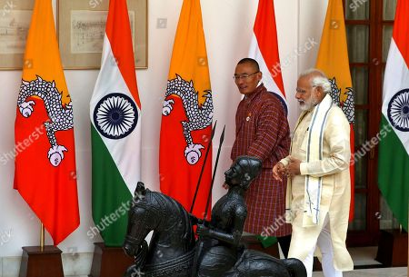Narendra Modi, Tshering Tobgay. Indian Prime Minister Narendra Modi, right, walks with his Bhutan counterpart Tshering Tobgay for a meeting in New Delhi, India, . Tobgay is on his three-day visit to India