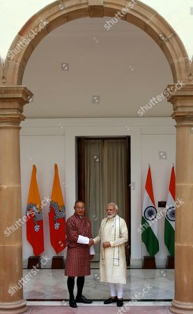 Narendra Modi, Tshering Tobgay. Indian Prime Minister Narendra Modi, right, shakes hand with his Bhutan counterpart Tshering Tobgay in New Delhi, India, . Tobgay is on his three-day visit to India