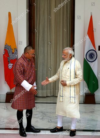Narendra Modi, Tshering Tobgay. Indian Prime Minister Narendra Modi, right, prepares to shake hand with his Bhutan counterpart Tshering Tobgay in New Delhi, India, . Tobgay is on his three-day visit to India