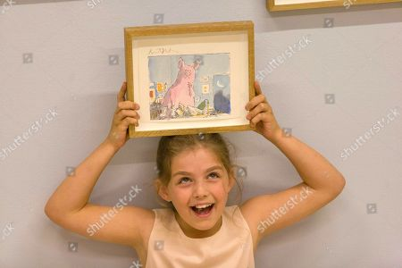 Child model Eliza Manson, 9 holds an alternative version of  'The Pig', from Roald Dahl's Dirty Beasts by Quentin Blake, 1984