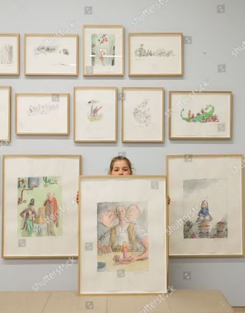 Child model Eliza Manson, 9 holds a signed watercolour, 'Sophie and the BFG', by Quentin Blake