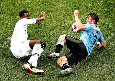 Cristian Rodriguez of Uruguay and Paul Pogba of France