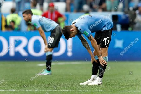 Stock Picture of Uruguay's Jonathan Urretaviscaya, left, and Uruguay's Matias Vecino, right, react after the quarterfinal match between Uruguay and France at the 2018 soccer World Cup in the Nizhny Novgorod Stadium, in Nizhny Novgorod, Russia, . France defeated Uruguay by 2-0