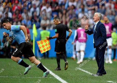 France head coach Didier Deschamps yells as Uruguay's Cristian Rodriguez, left, replaces Uruguay's Rodrigo Bentancur during the quarterfinal match between Uruguay and France at the 2018 soccer World Cup in the Nizhny Novgorod Stadium, in Nizhny Novgorod, Russia
