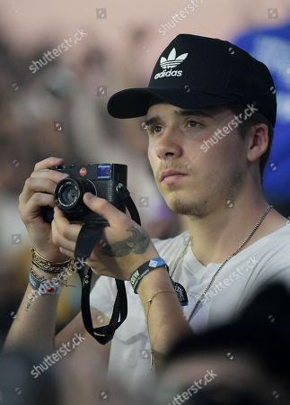 Brooklyn Beckham Brooklyn Beckham uses a leica camera as J. Cole performs on stage