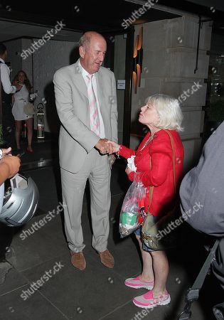 Stock Photo of Russ Abbot greets a fan