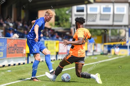 AFC Wimbledon Midfielder Mitchell Pinnock (11) and Reading Midfielder David Edwards (16) in action during the Pre-Season Friendly match between AFC Wimbledon and Reading at the Cherry Red Records Stadium, Kingston. Picture by Stephen Wright