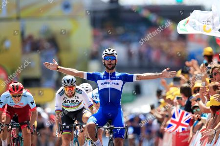 Colombia's Fernando Gaviria crosses the finish line ahead of Peter Sagan of Slovakia, left, and Germany's Marcel Kittel, far left, to win the first stage of the Tour de France cycling race over 201 kilometers (124.9 miles) with start in Noirmoutier-en-L'Ile and finish in Fontenay Le-Comte, France