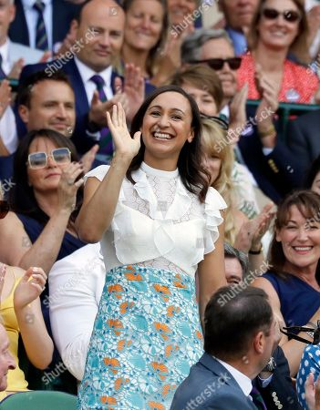 Former British athlete Jessica Ennis-Hill waves to the crowd from the Royal Box on Centre Court on the sixth day of the Wimbledon Tennis Championships in London