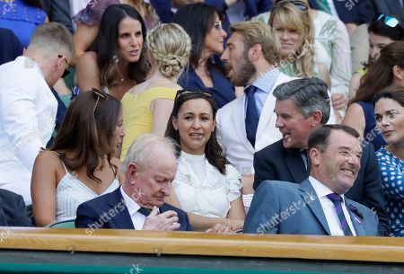 Former British athlete Jessica Ennis-Hill, center, and former Wimbledon champion Rod Laver, front left, sit in the Royal Box on Centre Court on the sixth day of the Wimbledon Tennis Championships in London
