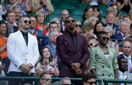 British boxers from left, Carl Froch, David Haye and Nicola Adams stand in the Royal Box on Centre Court on the sixth day of the Wimbledon Tennis Championships in London