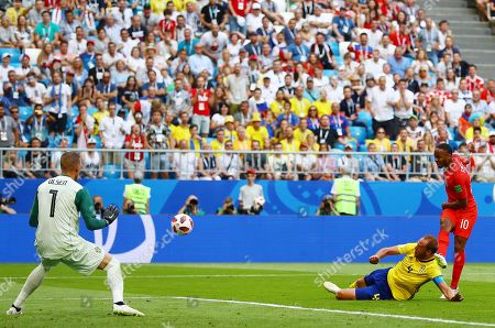 Andreas Granqvist of Sweden blocks Raheem Sterling of England's shot after Goalkeeper Robin Olsen had palmed the ball away 1 on 1 with the striker
