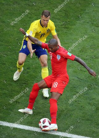Sweden's John Guidetti vies for the ball with England's Ashley Young, right, during the quarterfinal match between Sweden and England at the 2018 soccer World Cup in the Samara Arena, in Samara, Russia