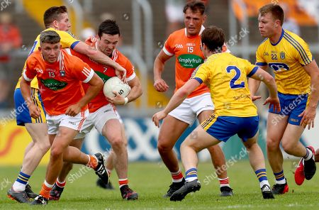 Roscommon vs Armagh. Roscommon's Sean Mc Dermott, David Murray and Niall Daly tackle Aidan Forker of Armagh