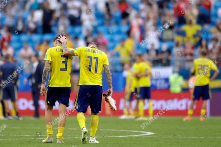 Sweden's Victor Lindelof and Sweden's John Guidetti react at the end of the quarterfinal match between Sweden and England at the 2018 soccer World Cup in the Samara Arena, in Samara, Russia