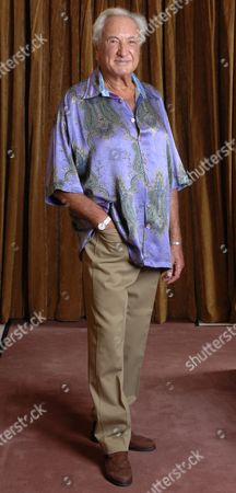 Michael Winner The 70-year-old Film Director Has Shed Three-and-a-half Stone. This Week He Said Dieting Means He Can Wear His 70s Wardrobe. Femail Put Him To The Test. Picture Shows: Michael Wearing A Lilac Paisley Shirt. 'this Was A Present In The Seventies From A Girlfriend Called Sparkle. Once I'd Had The Sleeves Chopped Off-i Only Like Short-sleeved Shirts-i Wore It For Costume And Make-up Tests For The Big Sleep The Raymond Chandler Thriller I Directed. I Remember Robert Mitchum Being Very Rude About It.' A Slim-line Michael Winner Steps Back To His 70's/80's Wardrobe.
