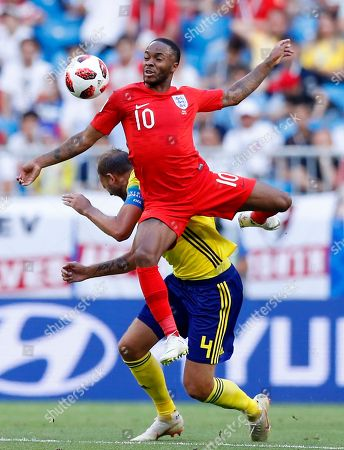 England's Raheem Sterling, top, challenges for the ball with Sweden's Andreas Granqvist as England's Harry Kane, left, looks them during the quarterfinal match between Sweden and England at the 2018 soccer World Cup in the Samara Arena, in Samara, Russia