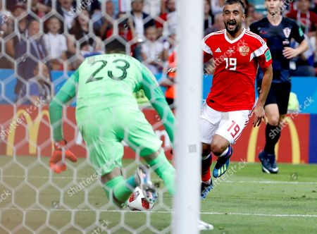 Goalkeeper Danijel Subasic of Croatia and Aleksandr Samedov of Russia