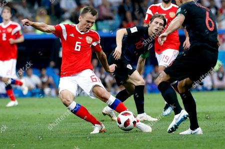 Stock Photo of Aleksandr Samedov of Russia (L) scores the 1-0 Luka Modric of Croatia looks on  during the FIFA World Cup 2018 quarter final soccer match between Russia and Croatia in Sochi, Russia, 07 July 2018.