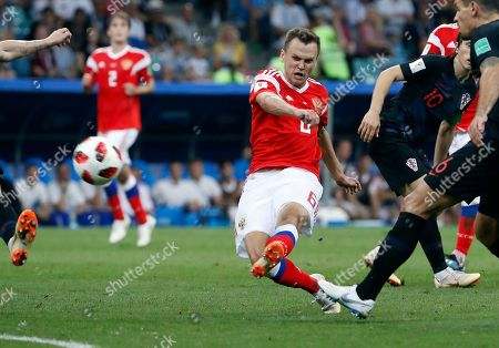 Stock Picture of Aleksandr Samedov of Russia (L) scores the 1-0 during the FIFA World Cup 2018 quarter final soccer match between Russia and Croatia in Sochi, Russia, 07 July 2018. (RESTRICTIONS APPLY: Editorial Use Only, not used in association with any commercial entity - Images must not be used in any form of alert service or push service of any kind including via mobile alert services, downloads to mobile devices or MMS messaging - Images must appear as still images and must not emulate match action video footage - No alteration is made to, and no text or image is superimposed over, any published image which: (a) intentionally obscures or removes a sponsor identification image; or (b) adds or overlays the commercial identification of any third party which is not officially associated with the FIFA World Cup)