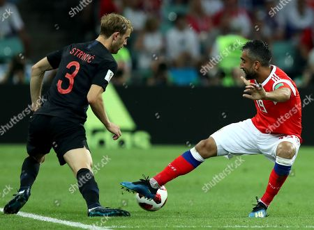 Stock Image of Ivan Strinic (L) of Croatia and Aleksandr Samedov of Russia in action during the FIFA World Cup 2018 quarter final soccer match between Russia and Croatia in Sochi, Russia, 07 July 2018.