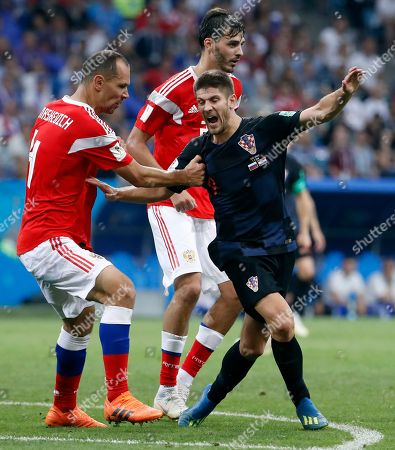 Sergei Ignashevich of Russia and Andrej Kramaric of Croatia
