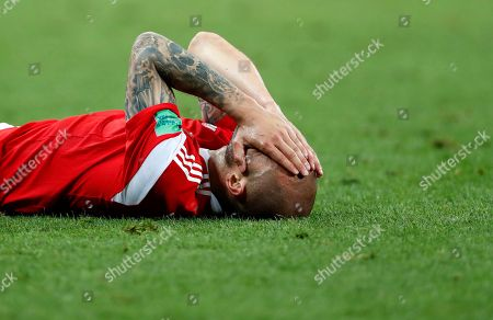 Russia's Fyodor Kudryashov reacts during the quarterfinal match between Russia and Croatia at the 2018 soccer World Cup in the Fisht Stadium, in Sochi, Russia
