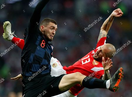 Croatia's Mateo Kovacic, left, duels for the ball with Russia's Fyodor Kudryashov during the quarterfinal match between Russia and Croatia at the 2018 soccer World Cup in the Fisht Stadium, in Sochi, Russia