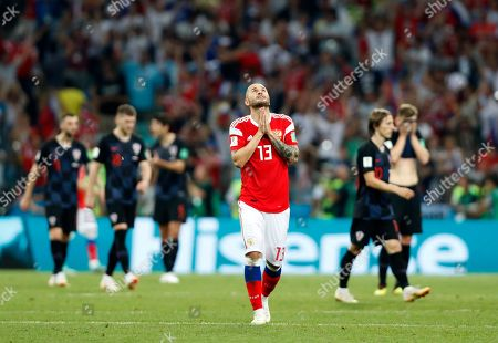 Russia's Fyodor Kudryashov, center, celebrates after Russia's Mario Fernandes scores his side's second goal during the quarterfinal match between Russia and Croatia at the 2018 soccer World Cup in the Fisht Stadium, in Sochi, Russia
