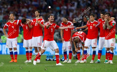 Stock Photo of Russia's Alan Dzagoev gestures during the penalty shootout at the quarterfinal match between Russia and Croatia at the 2018 soccer World Cup in the Fisht Stadium, in Sochi, Russia