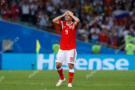 Russia's Alan Dzagoev reacts at the end of the quarterfinal match between Russia and Croatia at the 2018 soccer World Cup in the Fisht Stadium, in Sochi, Russia