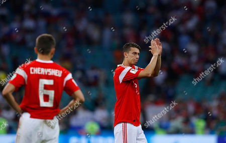 Russia's Ilya Kutepov, right, waves funs as his teammate Denis Cheryshev stands at the end of the quarterfinal match between Russia and Croatia at the 2018 soccer World Cup in the Fisht Stadium, in Sochi, Russia