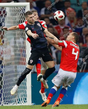 Croatia's Ante Rebic, centre, vies for the ball with Russia's Mario Fernandes and Russia's Sergei Ignashevich, right, during the quarterfinal match between Russia and Croatia at the 2018 soccer World Cup in the Fisht Stadium, in Sochi, Russia