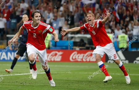 Russia's Mario Fernandes, left, and Yuri Gazinsky celebrates after scoring their side's second goal during the quarterfinal match between Russia and Croatia at the 2018 soccer World Cup in the Fisht Stadium, in Sochi, Russia