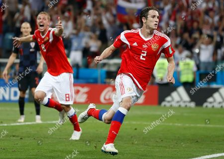 Russia's Mario Fernandes, right, and Yuri Gazinsky celebrates after scoring their side's second goal during the quarterfinal match between Russia and Croatia at the 2018 soccer World Cup in the Fisht Stadium, in Sochi, Russia