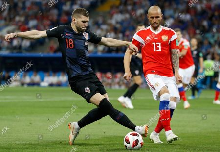 Croatia's Ante Rebic, left, vies for the ball with Russia's Fyodor Kudryashov during the quarterfinal match between Russia and Croatia at the 2018 soccer World Cup in the Fisht Stadium, in Sochi, Russia