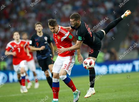 Russia's Ilya Kutepov, left, and Croatia's Ante Rebic challenge for the ball during the quarterfinal match between Russia and Croatia at the 2018 soccer World Cup in the Fisht Stadium, in Sochi, Russia