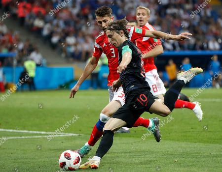 Croatia's Luka Modric and Russia's Ilya Kutepov challenge for the ball during the quarterfinal match between Russia and Croatia at the 2018 soccer World Cup in the Fisht Stadium, in Sochi, Russia