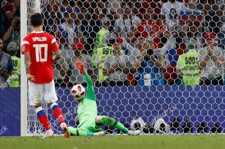 Croatia goalkeeper Danijel Subasic, right, makes a save during the penalty shootout in front of Russia's Fyodor Smolov during the quarterfinal match between Russia and Croatia at the 2018 soccer World Cup in the Fisht Stadium, in Sochi, Russia