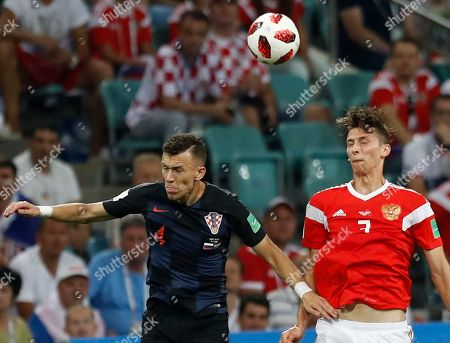 Croatia's Ivan Perisic, left, and Russia's Ilya Kutepov challenge for the ball during the quarterfinal match between Russia and Croatia at the 2018 soccer World Cup in the Fisht Stadium, in Sochi, Russia