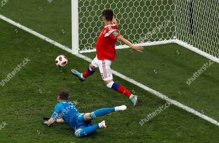 Russia goalkeeper Igor Akinfeev, on the ground and Russia's Ilya Kutepov watch the ball hit the post during the quarterfinal match between Russia and Croatia at the 2018 soccer World Cup at the Fisht Stadium in Sochi, Russia