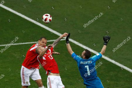 Stock Image of Russia goalkeeper Igor Akinfeev, right, jumps for the ball with teammates Sergei Ignashevich, left, and Fyodor Kudryashov during the quarterfinal match between Russia and Croatia at the 2018 soccer World Cup at the Fisht Stadium in Sochi, Russia