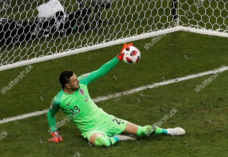 Croatia goalkeeper Danijel Subasic stops a shot from Russia's Fyodor Smolov during a penalty shootout at the end of the quarterfinal match between Russia and Croatia at the 2018 soccer World Cup at the Fisht Stadium in Sochi, Russia