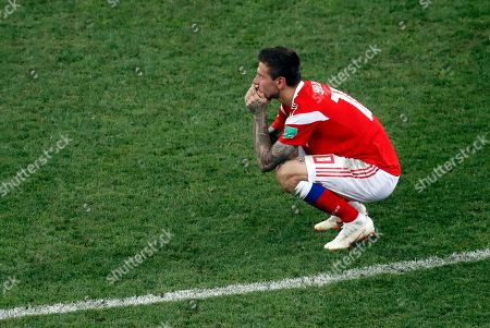Russia's Fyodor Smolov reacts after Croatia defeated Russia in a penalty shootout at the end of the quarterfinal match between Russia and Croatia at the 2018 soccer World Cup at the Fisht Stadium in Sochi, Russia