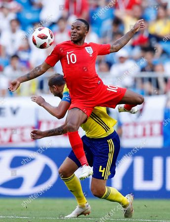 England's Raheem Sterling, top, challenges for the ball with Sweden's Andreas Granqvist during the quarterfinal match between Sweden and England at the 2018 soccer World Cup in the Samara Arena, in Samara, Russia