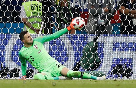 Croatia goalkeeper Danijel Subasic makes a save during the penalty shootout from Russia's Fyodor Smolov during the quarterfinal match between Russia and Croatia at the 2018 soccer World Cup in the Fisht Stadium, in Sochi, Russia